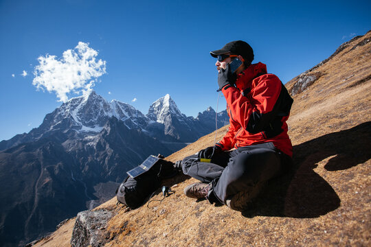 Man talking on his cellphone in mountain