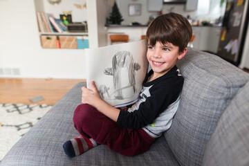 boy draws cartoon penguin
