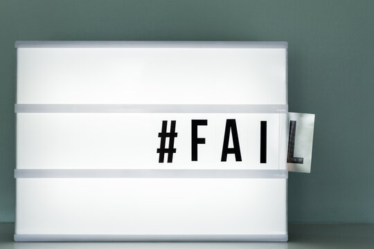 lightbox with the word fail falling out