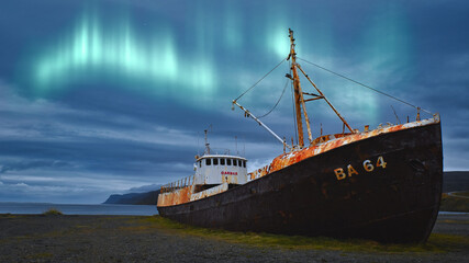 aurora borealis enjoyed in front of a ship wreck during an autumn holiday in iceland