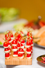 Mozzarella cheese and tomatoes on a stick.