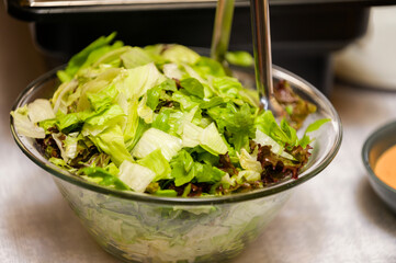 Glass bowl with salad for a celebration.