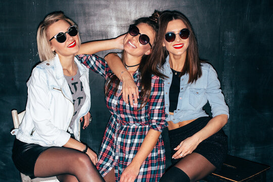 Happy young stylish girls have fun on night party