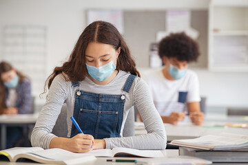 Wall Murals Height scale High school girl studying in class with face mask