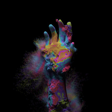 Disintegrating hand made of colorful sand