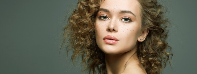 Beautiful freckles woman with curl hairstyle and make-up