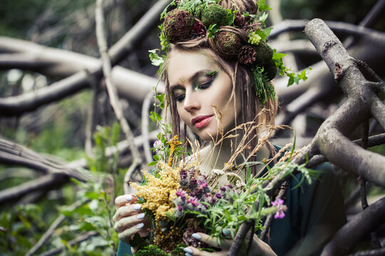 Beautiful woman outdoors. Halloween character or Forest soul