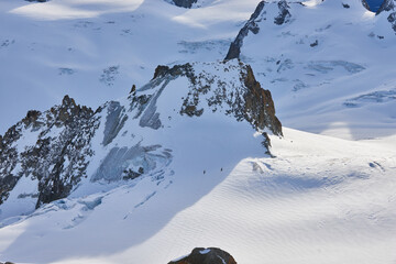 White snowy valley with glaciers and mountain peaks. View from Aiguille du Midi, Chamonix, France.