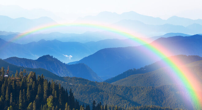 Misty view of the blue mountain range with amazing rainbow -  Beautiful landscape with cascade blue mountains at the morning