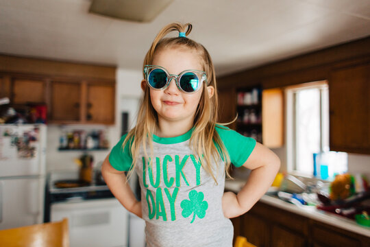 Toddler child in Lucky Day Saint Patrick's Day shirt in kitchen.
