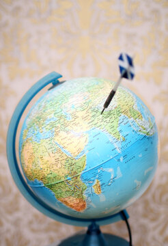 Dart thrown at a globe, to pick a travel destination