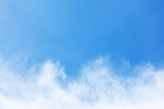 Fantastic soft white clouds against blue sky and copy space.