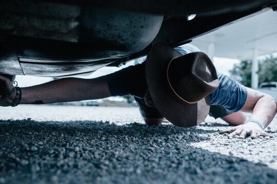 Man working on his broken down van