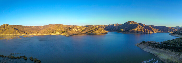 a stunning aerial shot of the deep blue lake water and mountains at Lake Piru in the Los Padres...
