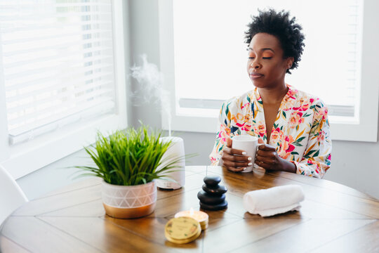 Black woman relaxing and meditating at home