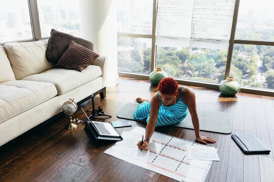Black woman having virtual brainstorm meeting at home during pandemic