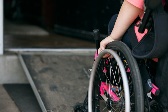 Girl In Wheelchair About To Use Ramp To Enter Home