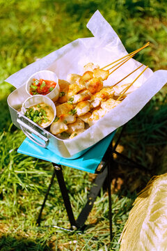 Picnic in the meadow. Chicken kebabs
