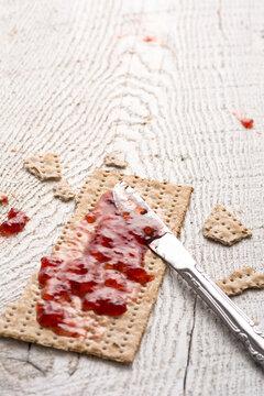 Whole Wheat Jewish Matzah at Passover and Strawberry Preserves