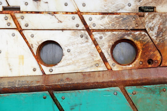 The hull of an old boat appears to have two eyes