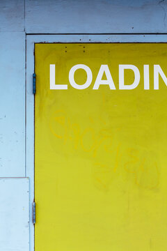 Loading sign on doorway, building exterior