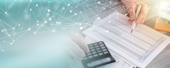 Hands of accountant businessman with calculator; panoramic banner