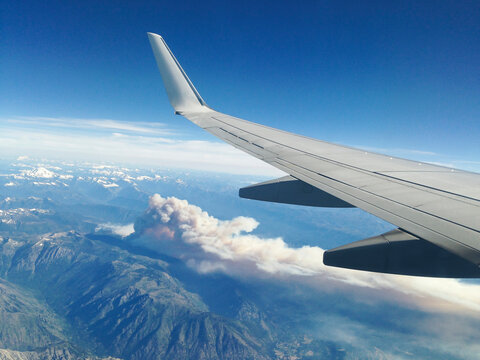 View from passenger jet of forest fire