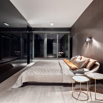 Elegant bedroom at night with lights on