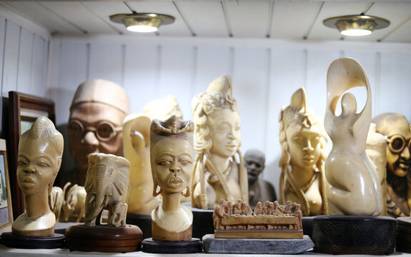 A view shows artworks on a shelf in Yemisi Shyllon's home, in Lagos
