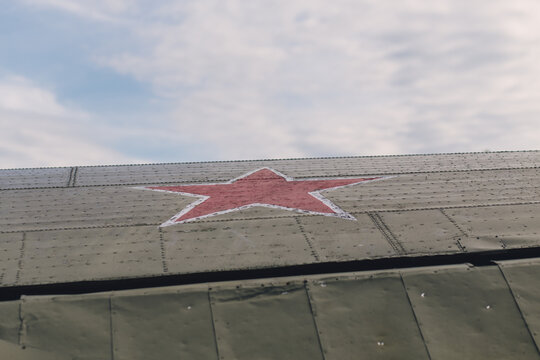 Wing of an old Soviet airplane with red star insignia