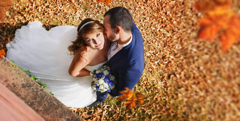 A beautiful photo Bride and groom in autumn - golden october