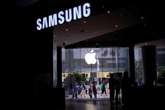Logos of Apple and Samsung are seen at a main shopping area following the coronavirus disease (COVID-19) outbreak in Shanghai