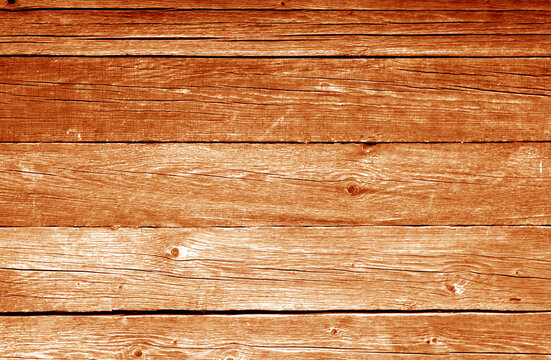 Old grungy wooden planks background in orange color.