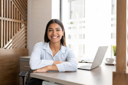 Happy female executive at work
