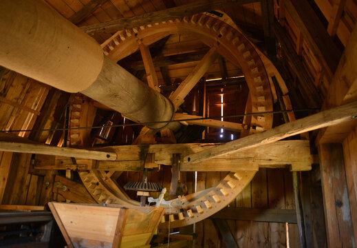Traditonal windmill interior wooden wheel mill technology from the last century