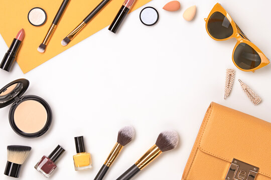 Beauty cosmetic makeup set. Fashion woman make up product, brushes, lipstick, nail polish collection. Creative yellow concept. Cosmetology make-up accessories banner, top view.