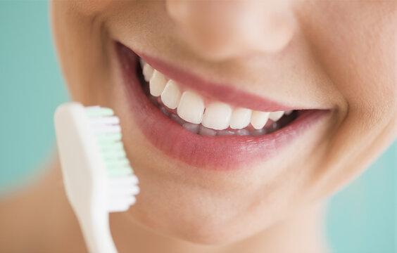Close-up of woman brushing teeth