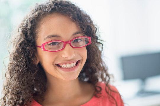 Portrait of schoolgirl (8-9) wearing pink eyeglasses