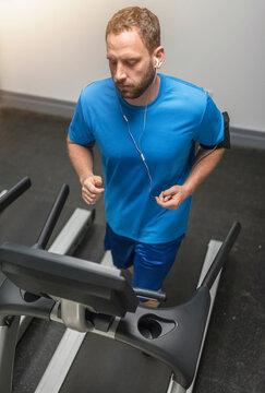 Mid adult man exercising on treadmill