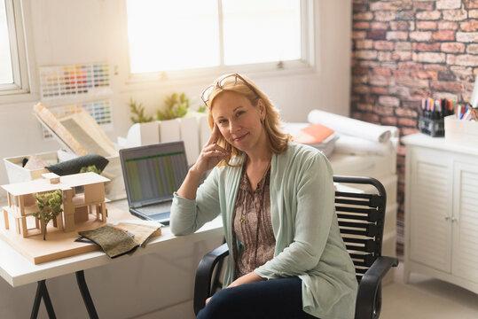 Female interior designer at work