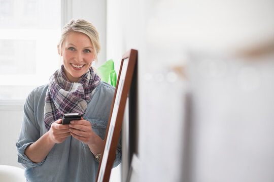 Portrait of woman using cell phone