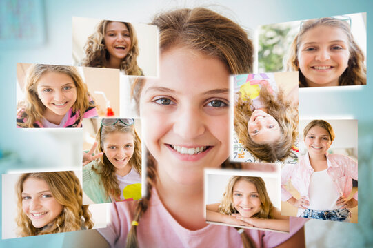Girl (12-13) surrounded by photos of herself