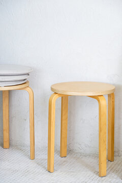 Wooden stool in the minimal style.