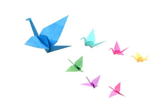 Origami birds flying on white background