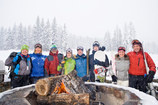 Portrait of group of friends with bonfire in winter