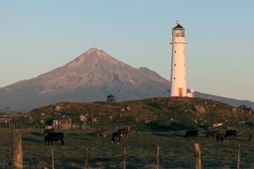 Mount Taranaki and lighthouse at sunset