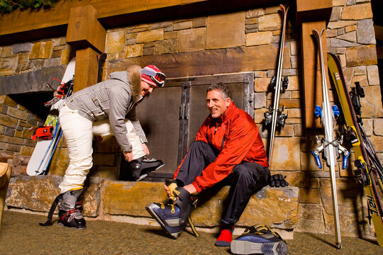 Skier putting on ski boots