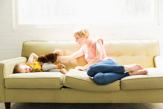 Mother playing with baby daughter (12-17 months)