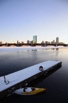 View across partially frozen Charles river to Longfellow Bridge and Boston