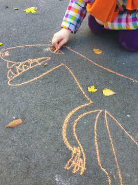 Child drawing made by chalk on a pavement